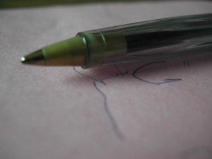A picture of a pen and some writing